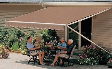 Family under brown awning