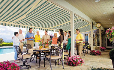 Family having a party under an awning